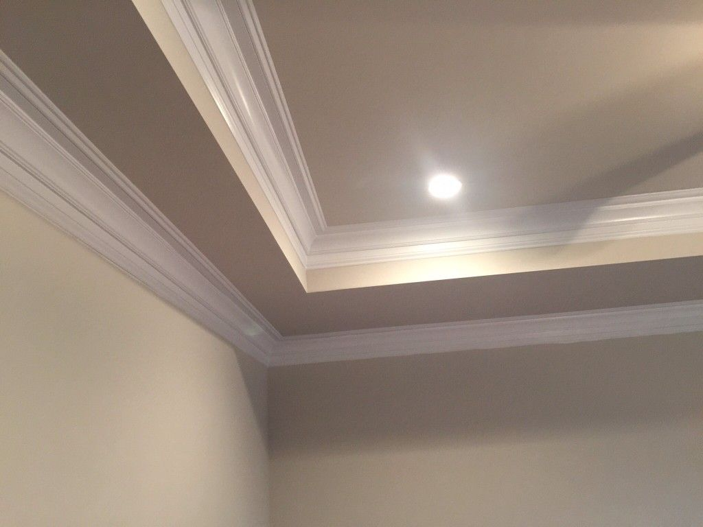 I don't like this crown moulding / coffered ceiling look ...
