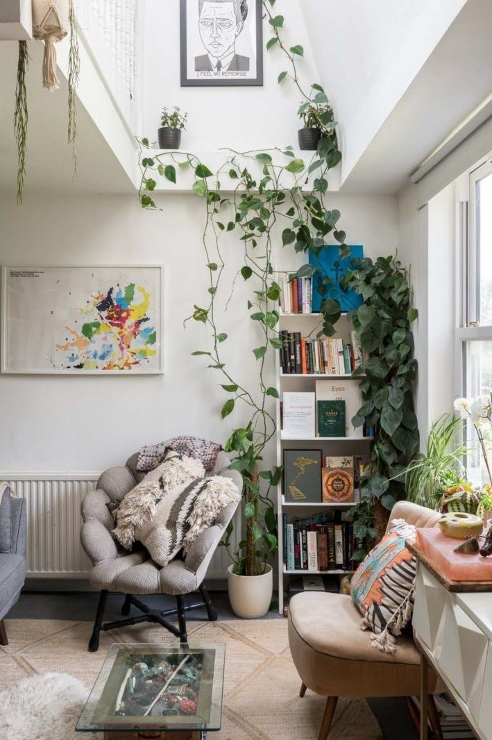 A bright and cluttered book-filled apartment in London
