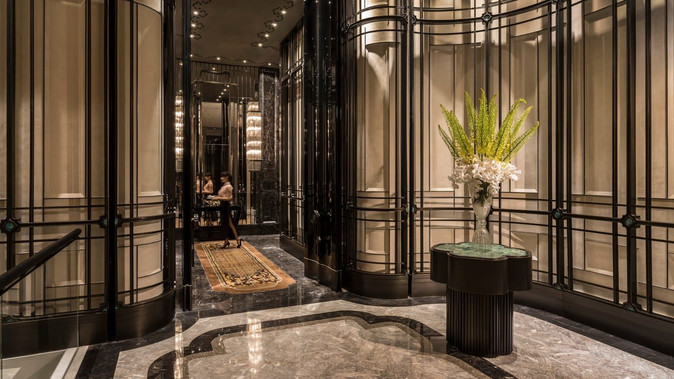 Shang Xi Restaurant Entrance With Marble Floors Walls Tall Vase