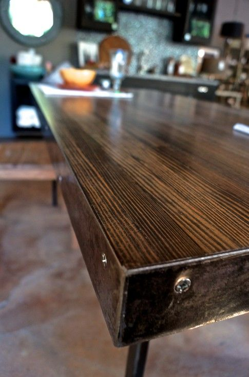 The Dining Table Is Made From Reclaimed Bowling Alley Flooring