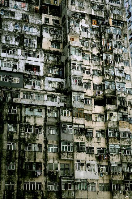 Battleship island in Japan. The entire island housed 3x what it should have, and managed it by putting them in obscenely crowded apartments like this. Now, the entire island is abandoned, and is restricted to the public. These derelict sky-scraping ghettos fall without an ear to hear them.