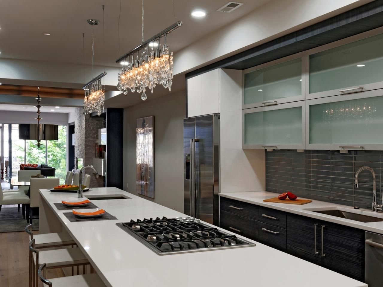 Two bars of luxe crystal track lights hang over this spacious ...