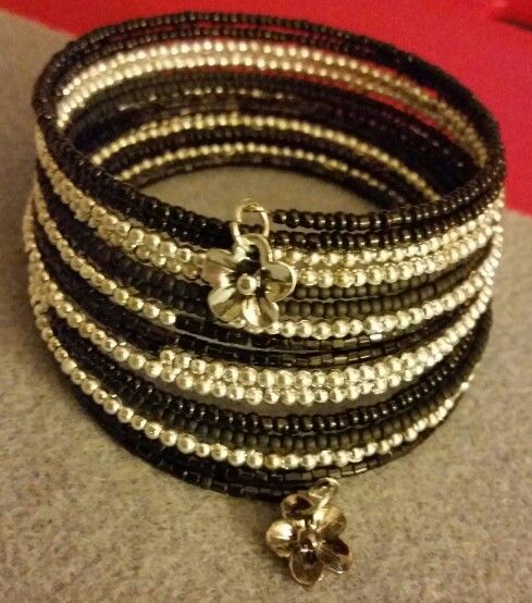 Handmade silver and black matte and shiny seed beads on memory wire.