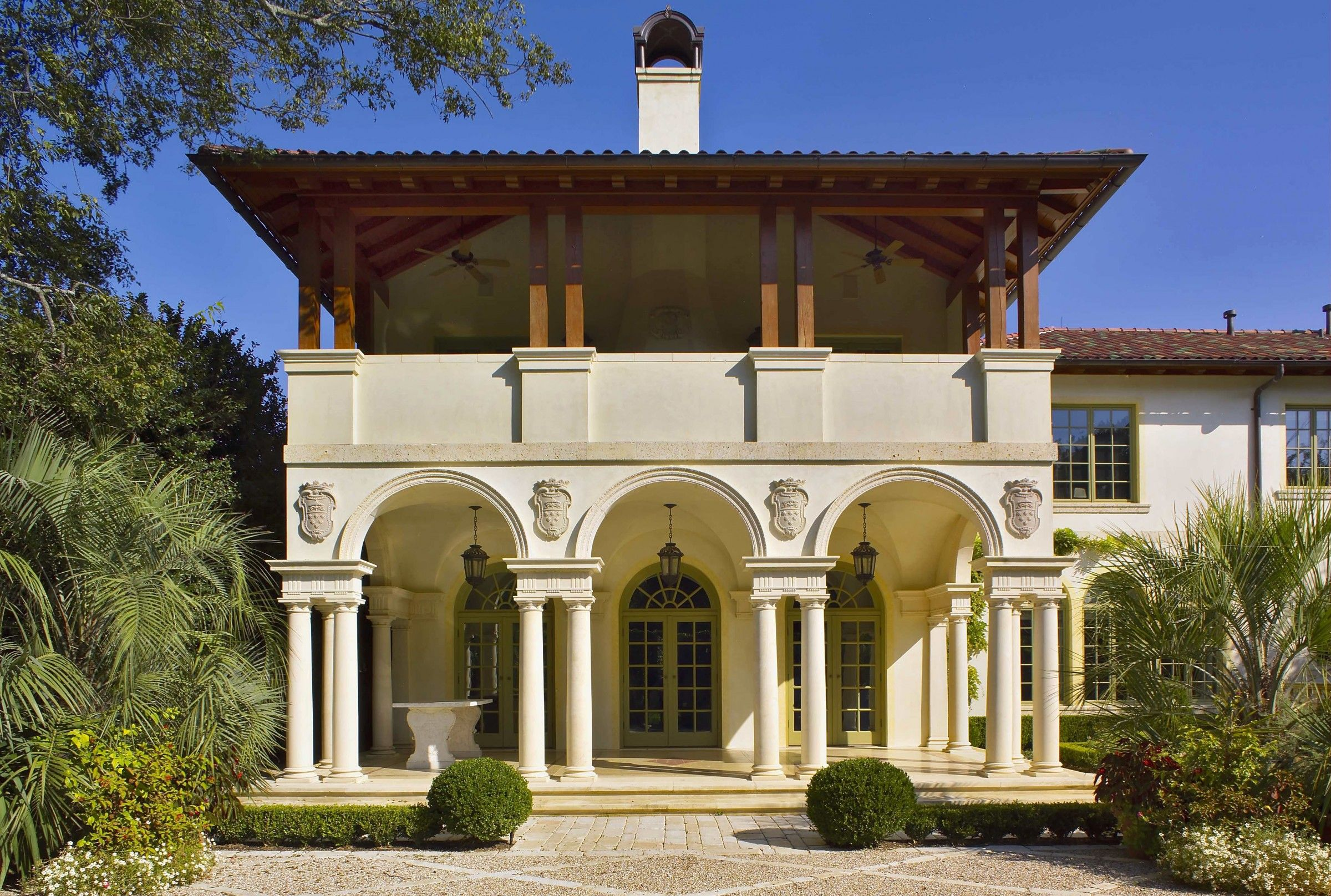 Exterior colonnade entrance with 2nd story deck for an for Italian villa architecture