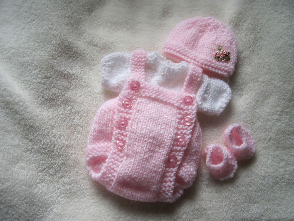 Hand knitted dolls clothes for 8-9\