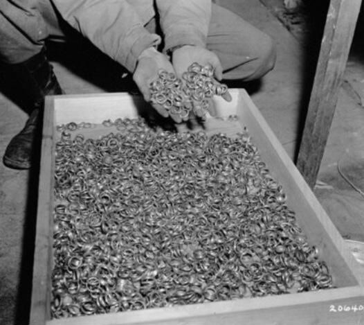 Wedding rings from WW II concentration camps. Each pair of rings represents a family, a marriage, a couple. 1945.