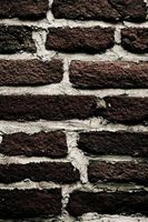 Dangers Of Cracks In Brick Walls Brick Wall Brick Wall Living Room Brick Shed