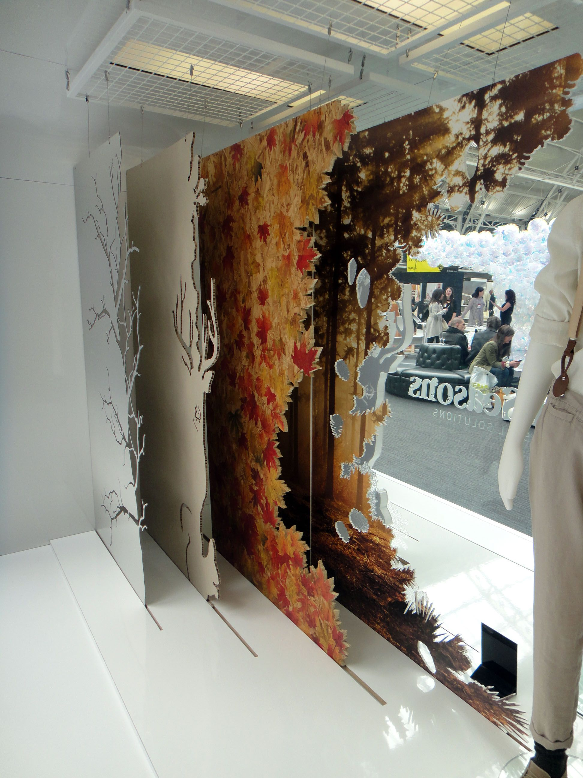 Layered window graphics our work found on pinterest for Retail shop display ideas