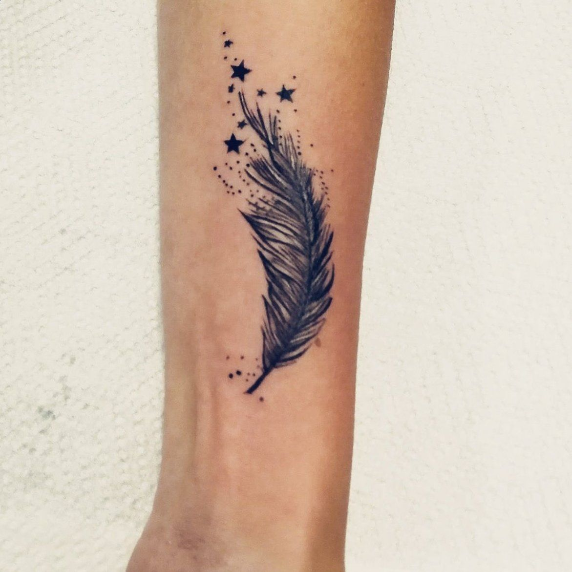 Feather and stars wrist tattoo. I love it! 😍 wrist