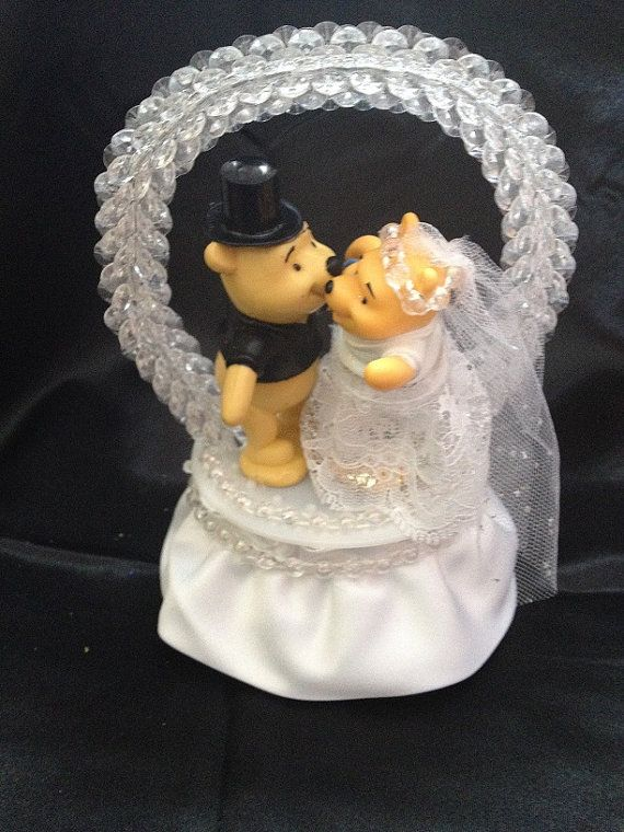 This Cake Topper Contains Winnie The Pooh As A Bride And Groom Are Standing On Base Wred In White Satin Clear Beads