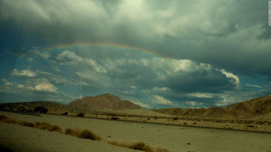"""A rainbow is spotted on the drive between Las Vegas and Los Angeles. """"The desert with its wide open spaces is really beautiful with endless skies,"""" <a href=""""http://ireport.cnn.com/docs/DOC-1256924"""">Marie Sager said.</a>"""