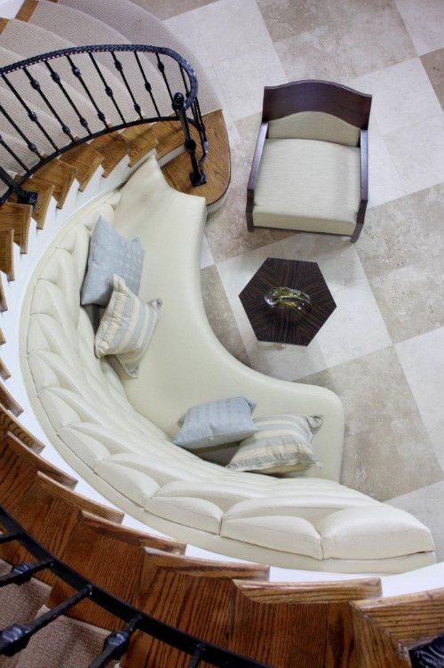 Built In Bench For Curved Staircase Provides Nice Seating