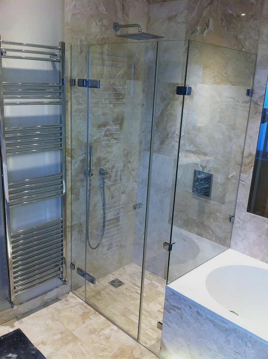 Large bespoke frameless end of bath shower enclosure with dwarf over ...