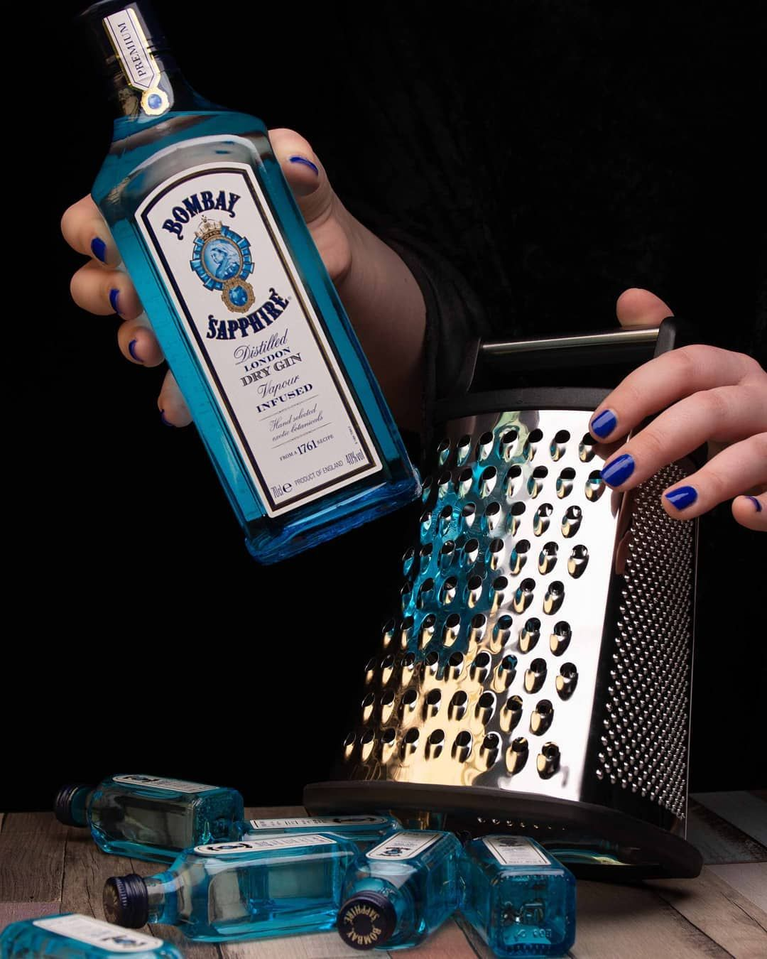Gin. #minatures #gin #bombaysapphire #bombaysapphiregin #grater #amber #studiophotography #nikond7200 #nikonphotography #nikon #reflections #blueglass #bluenails #drinkresponsibly #bombaydistillery? #ginoclock #londondrygin
