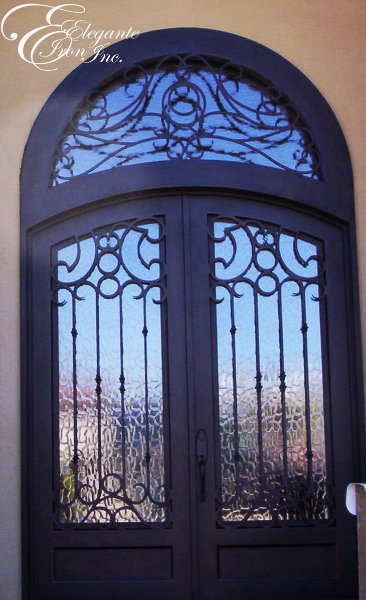 Custom Wrought Iron Door With Eyebrow Arch And An Attached