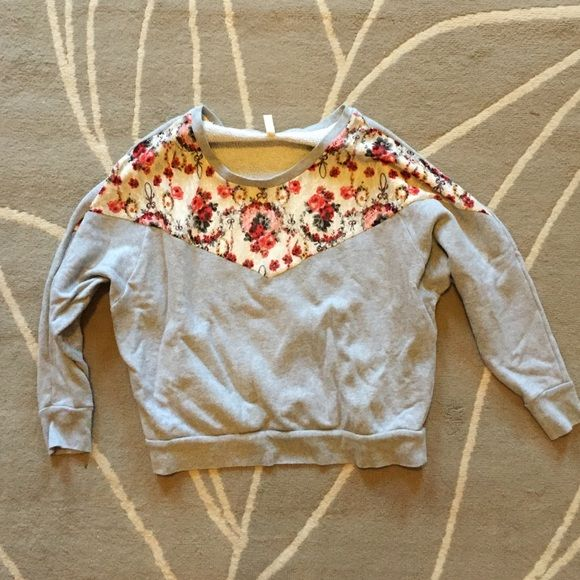 Free People Sweatshirt Grey sweatshirt with floral top.                                                             ️ Free People Tops Sweatshirts & Hoodies