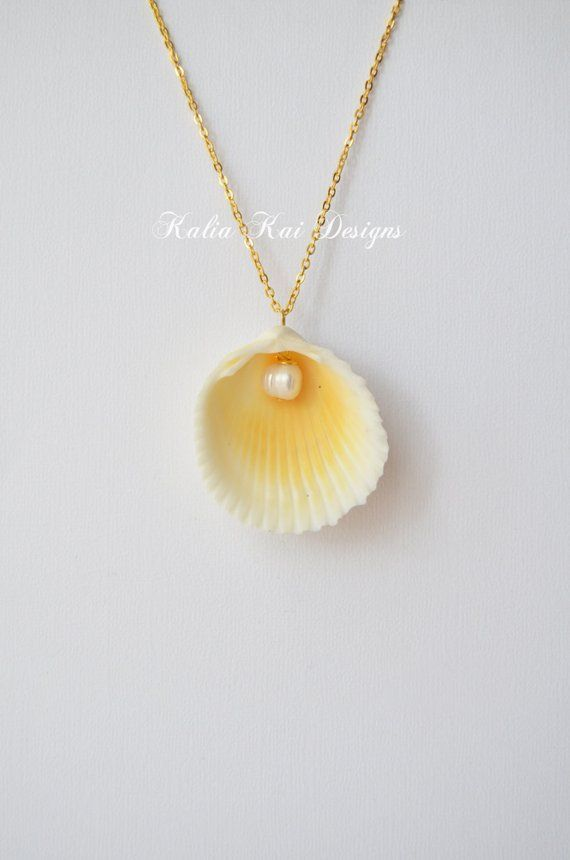 Classic shell and pearl dangle necklace, beautiful bright yellow shell, pearl necklace, sea shell necklace, gold plated is part of Seashell necklace - policy ref shopinfo policies leftnav  Payment & Shipment   Item will be shipped out within 2 days of received payment  Item will be packaged properly to protect it   Shipping carrier is USPS, unless otherwise requested     Shipping usually takes 25 days to arrive after created   International shipping is available  Please convo me for shipping rate  Thank you for stopping by  Kalia Kai Designs  Please  Like  our page on Facebook! Now on Instagram too!! All Unique and handmade items by Kalia Kai Designs are under Copyright  Please be respectful of these designs and copyright laws! Questions   Contact us