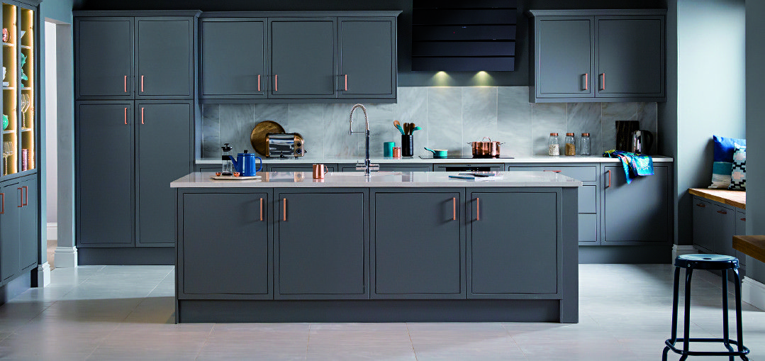 Grey with white worktop. Marble tiled splash back to make