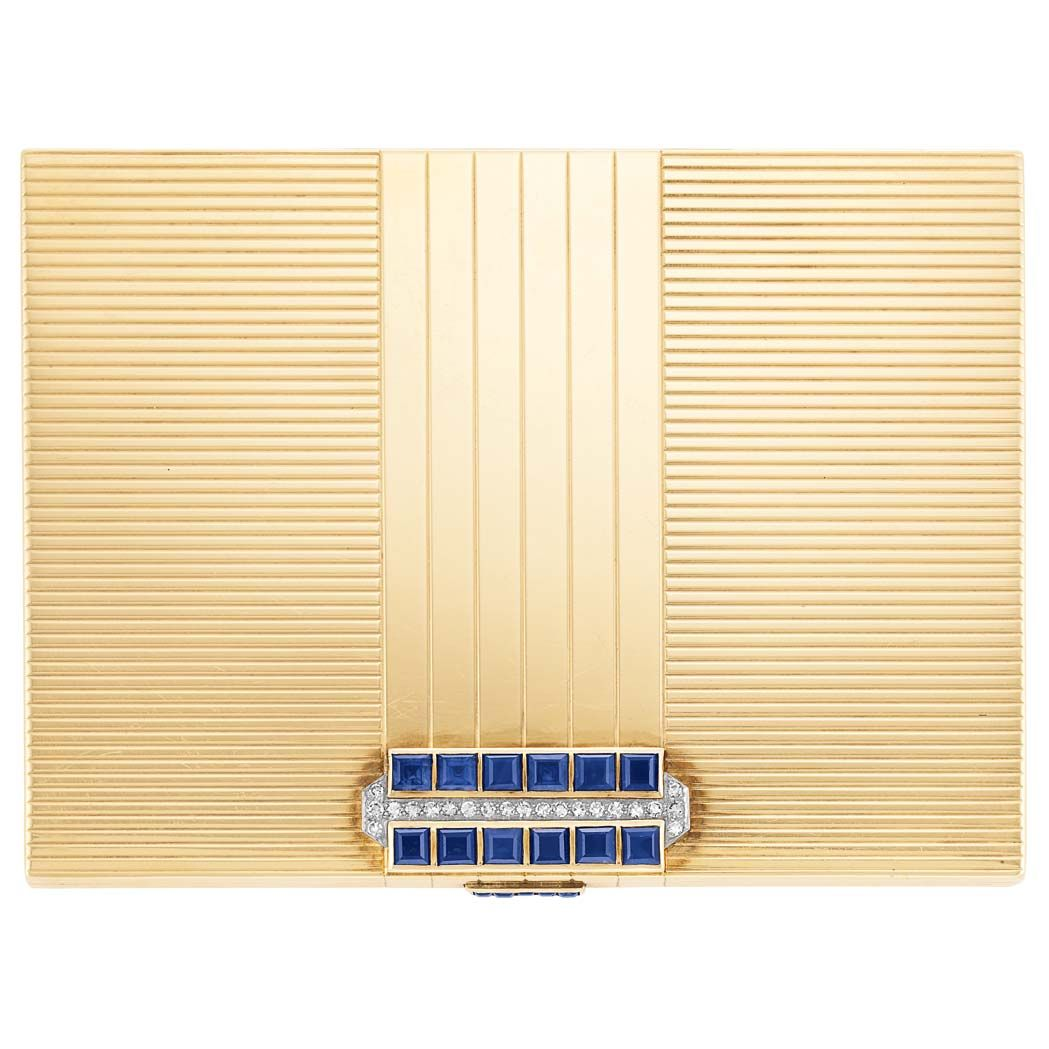 Gold, Platinum, Sapphire and Diamond Case 14 kt., the rectangular ribbed gold case surmounted by a panel of 12 square-cut sapphires approximately 5.25 cts., spaced by 21 platinum-set single-cut diamonds, with thumbpiece set with 5 small square-cut sapphires, circa 1938