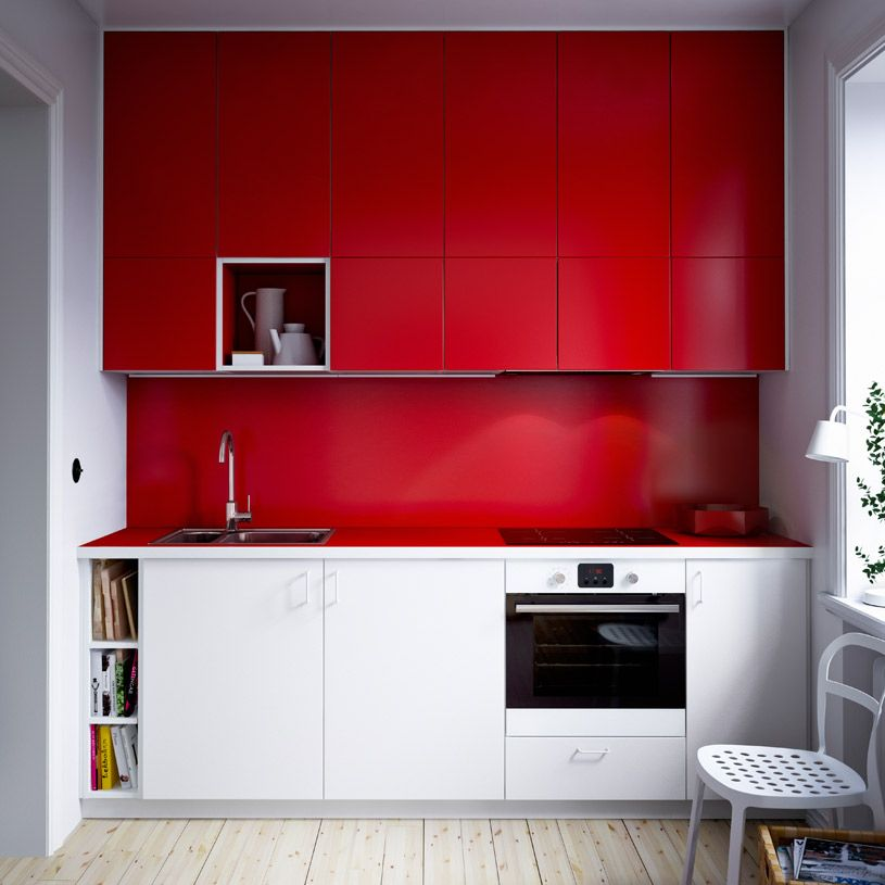 compact modern ikea kitchen with combination of white and red cabinet doors and red laminate
