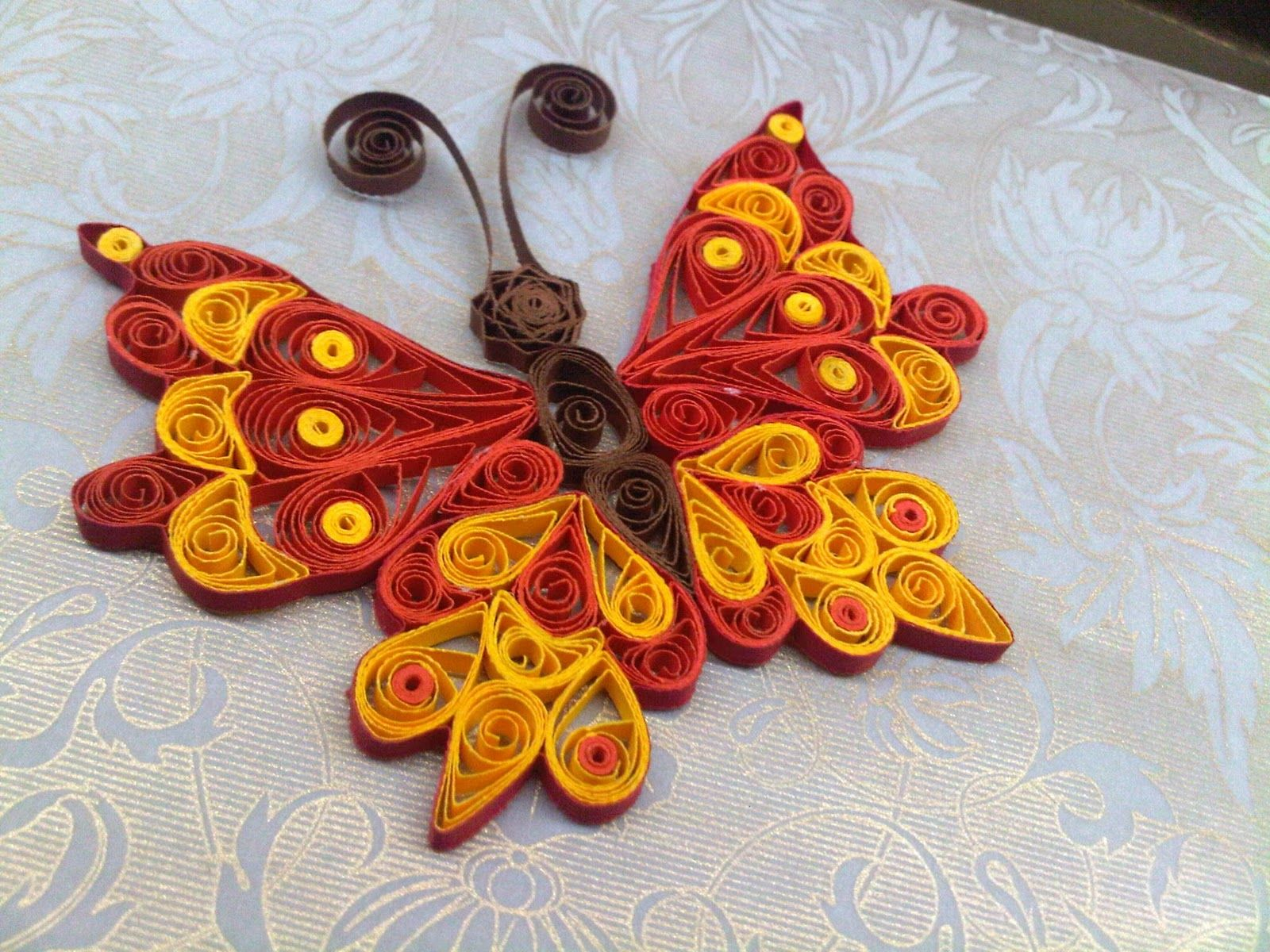 A quilled butterfly embellishment steps by step for Paper quilling designs
