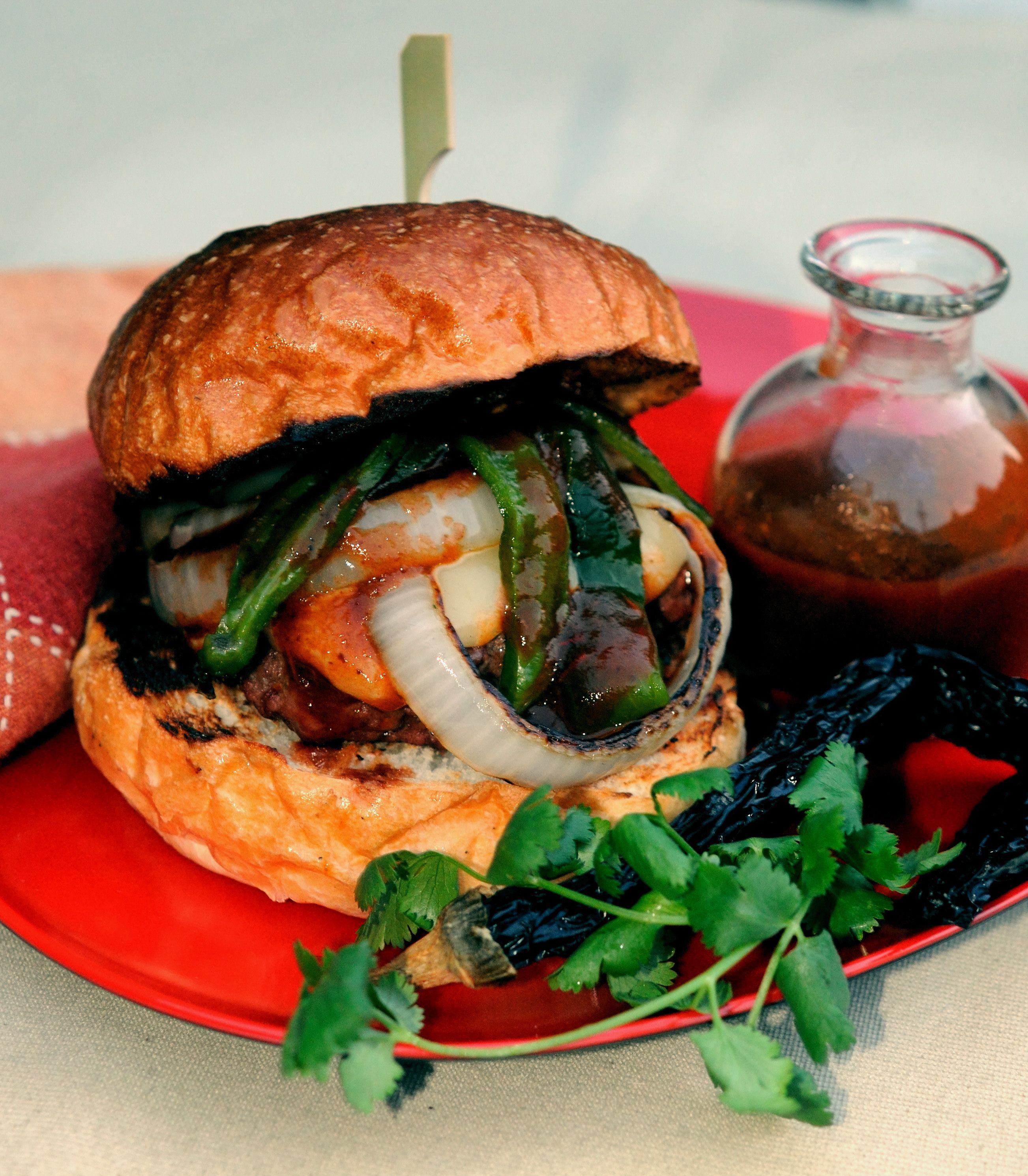 Get our the barbecue!  A scrumptious combination of roasted poblano chilies, grilled onions and a homemade chipotle salsa topping a turkey burger!  Awesome!  http://oracibo.com/recipe/burgers-with-grilled-peppers-grilled-onions-and-chipotle-salsa/