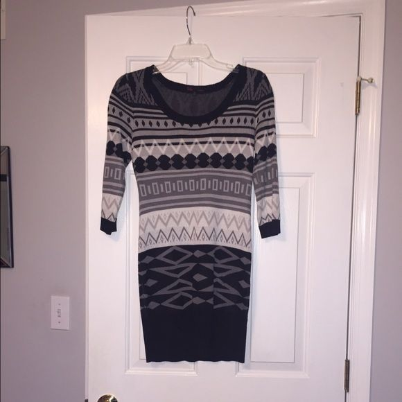 Winter sweater dress Sweater dresses are my favorite and perfect for this time of the year. This one has a cool pattern on it and it's white, gray, and black. The bottom is right above the knee but obviously depends on your height. The sleeves are 3/4 length. I only wore this once or twice. WILLING TO NEGOTIATE! USE THE OFFER BUTTON!  Dresses