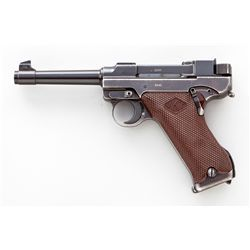 1st Variation Lahti L-35 Semi-Automatic Pistol, #2245, 9mm, 4.7'' barrel, blue finish, brown checkered plastic grips with VKT logo, cut for shoulder stock, with rounded Loaded Chamber indicator; early narrow upper receiver marked ''VKT/L-35''; rear portion raised area with forward protrusion for locking block spring (omitted from later models); with etched letter ''E'' to right side of trigger and takedown latch. Produced from 1939-1941 in serial range 1105-3700, with estimated production…