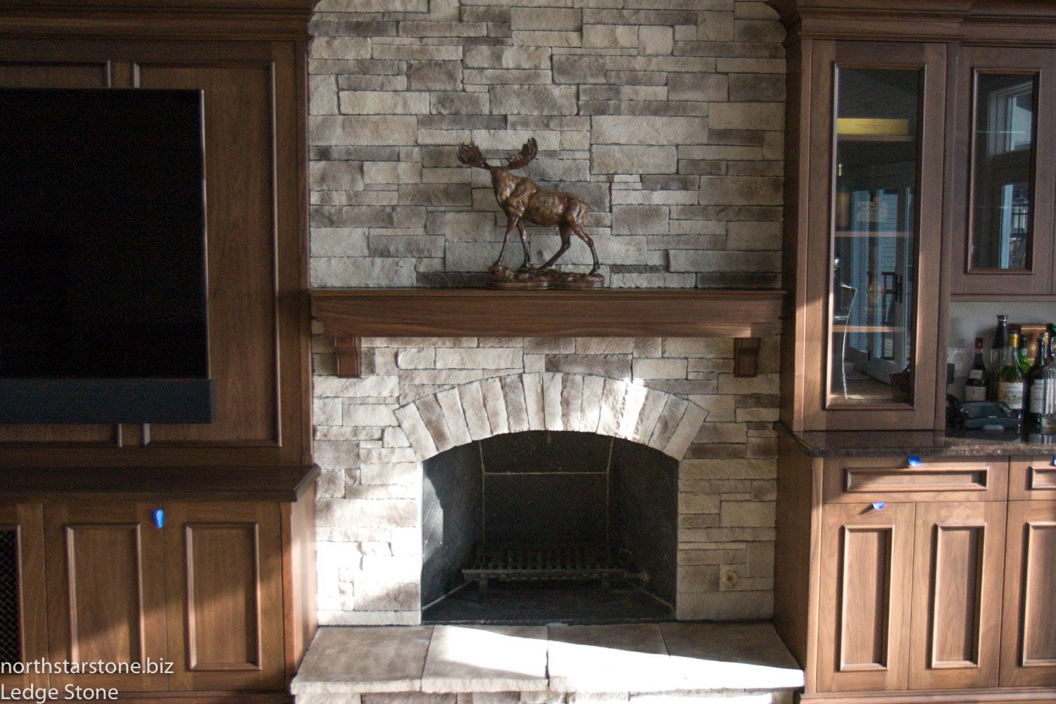 This Fireplace In Ledge Stone With A Smokey Brown Mist