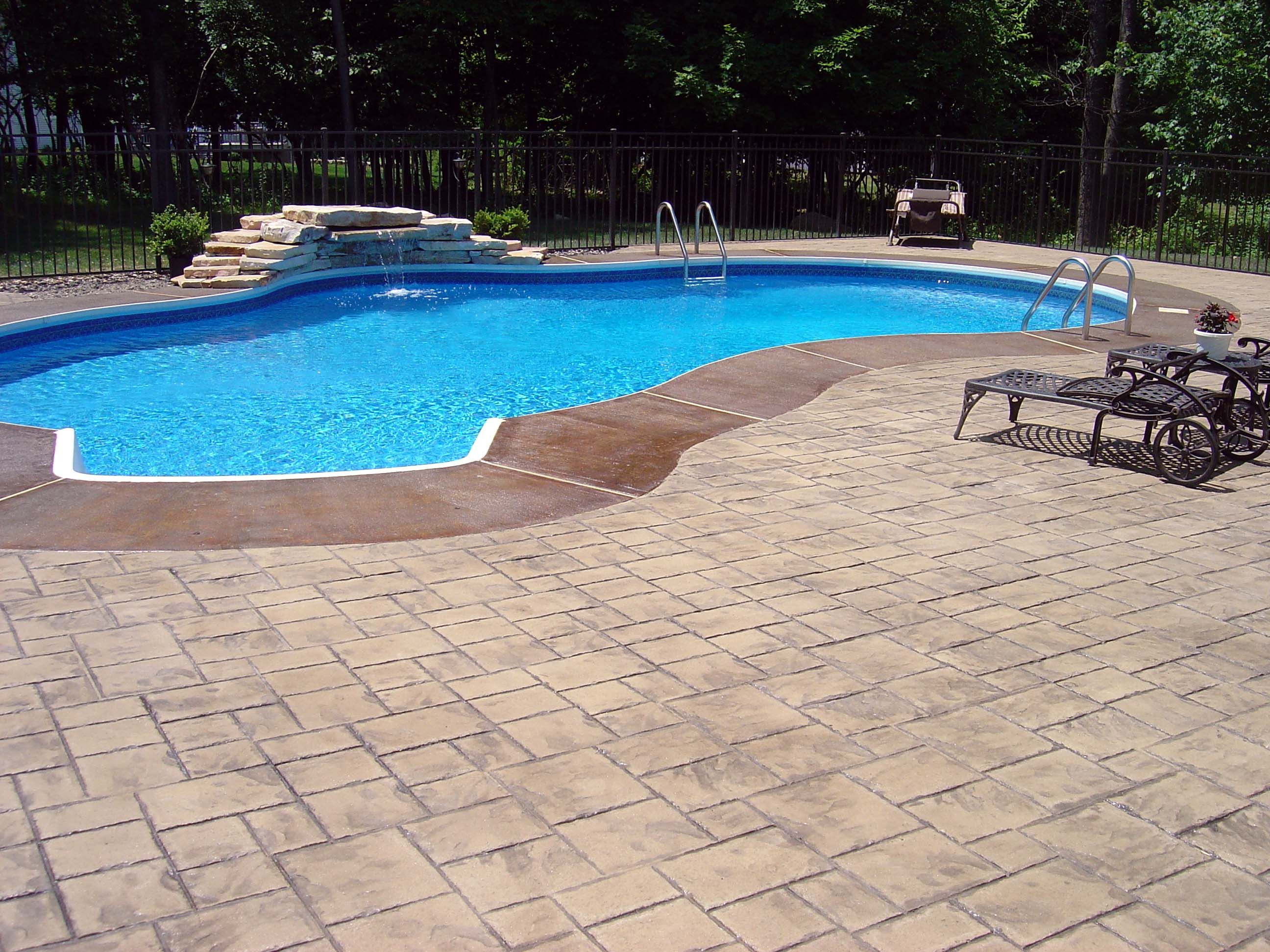 Concrete Pool Ideas this decorative concrete pool deck stayed with concretes natural coloring and also included subtle texturing Stamped Concrete Pool Patio