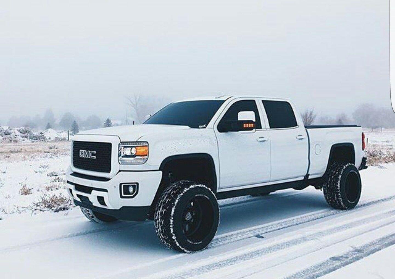 white gmc denali duramax diesel black wheels tinted in snow [ 1440 x 1017 Pixel ]