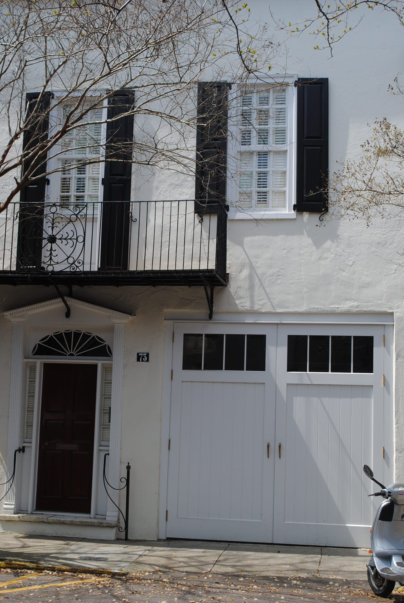 Carriage garage doors without windows  Unique  a garage door beside the front door  Charleston SC