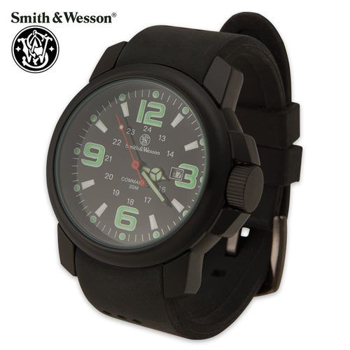 The Smith & Wesson Amphibian Commando watch is a rugged, no-nonsense piece of equipment. Fully coordinated in black, houses a Japanese quartz movement with a large thick weather proof polyurethane strap with metal buckle. Light weight only 3 oz. The large 3 6 9 12 numbers are luminous green along with the hour and minute hands; while the white luminous bars show the remaining hours. Other features: 24 hour markings; date window; luminous red sweep second hand; water resistant to 30M.