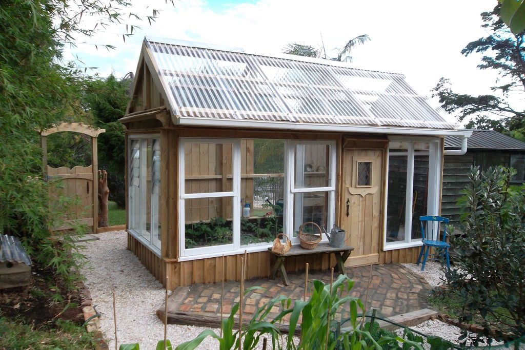 Greenhouse made from recycled windows gardens for Reclaimed window greenhouse