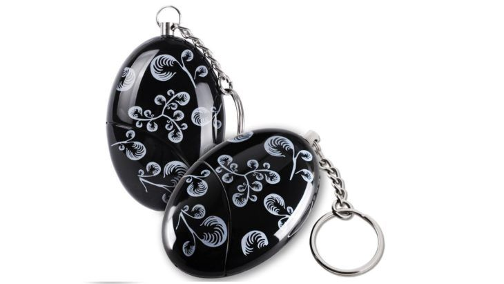 A stylish looking personal alarm for women keychain pin