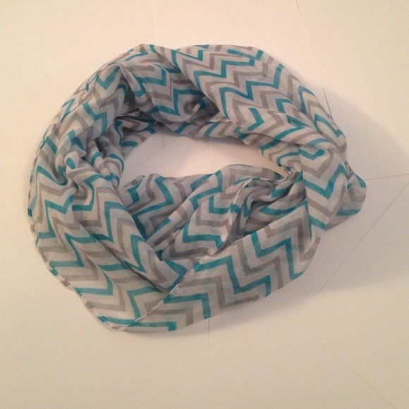 Chevron infinity scarf. Lightweight and super fun! Lightweight infinity scarf that's perfect for spring weather! Would look great with a basic white tee and a denim jacket! Caramel Cantina Accessories Scarves & Wraps