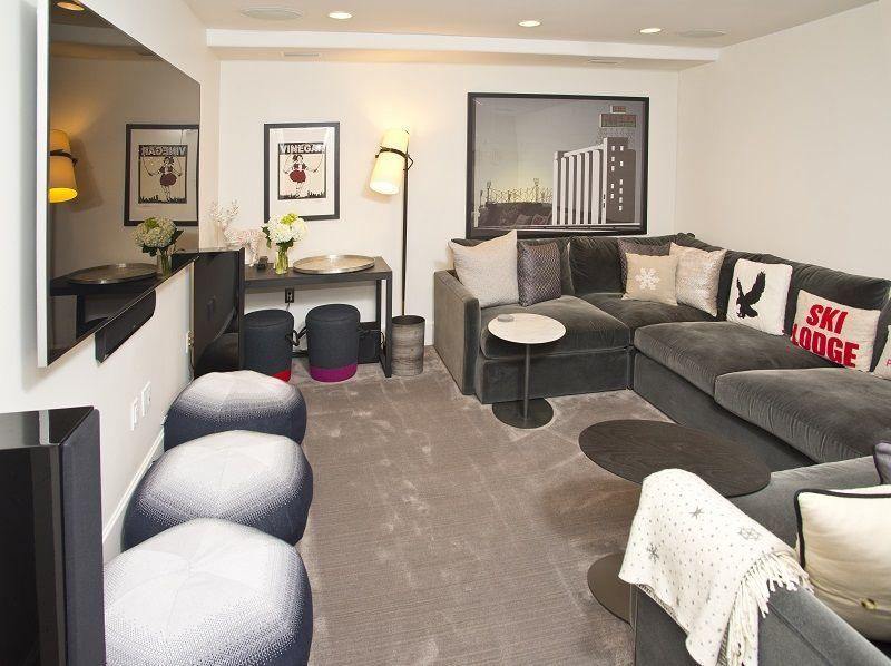 The downstairs media room features ample seating and a massive Flat screen TV