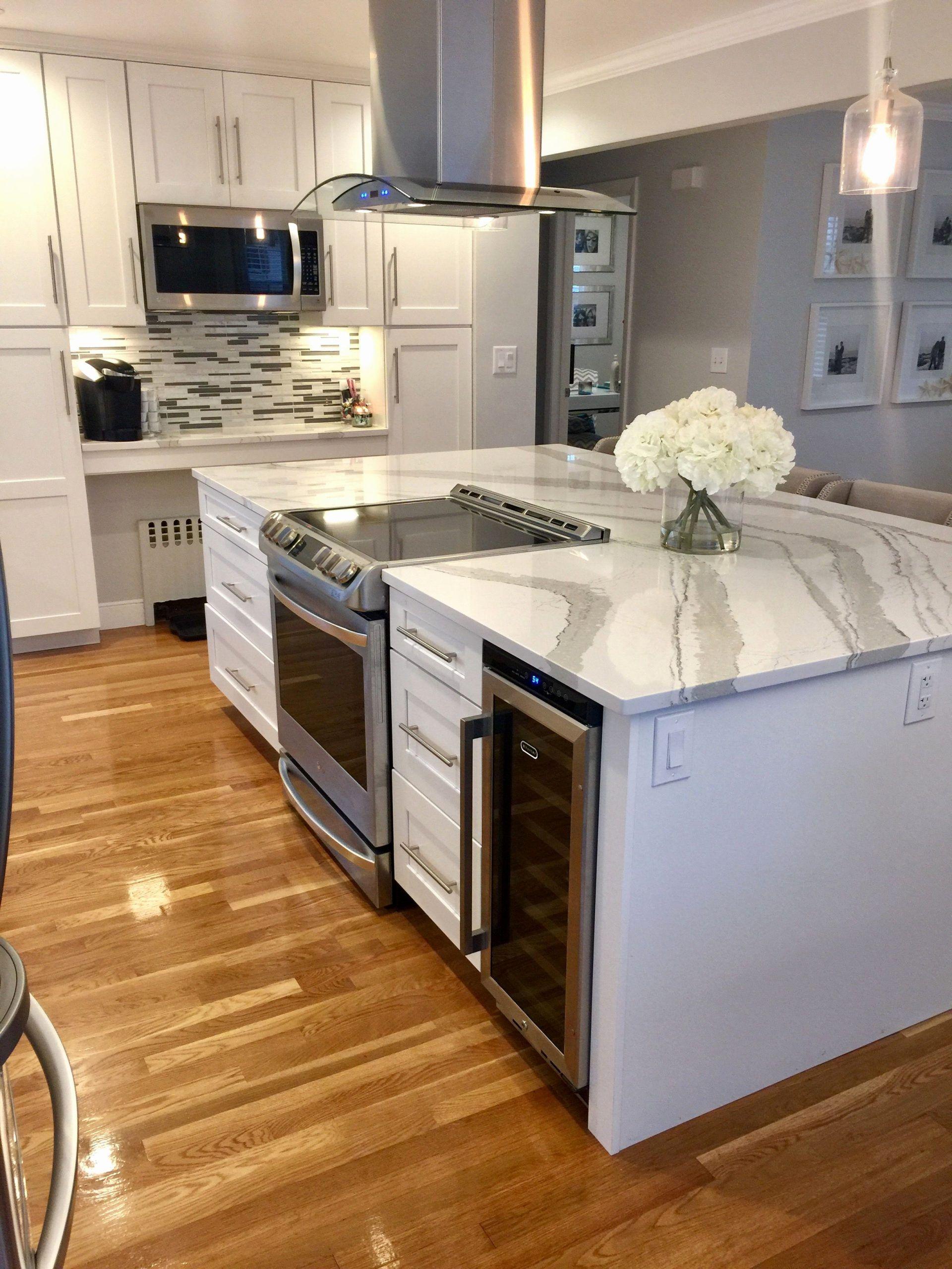 Open Kitchen Plans With Island Elegant Huge Quartz Island With Stove And Wine Fridge Open Flo Elegant Kitchen Island Kitchen Remodel Small Diy Kitchen Flooring