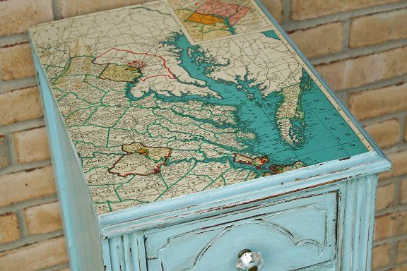 Creative Uses for Old Maps - Holy Toledo, Batman, I LOVE this table! This would be such an easy redo project for a weekend. I've been trying to come up with cute ways to use maps for decorating and this is great!