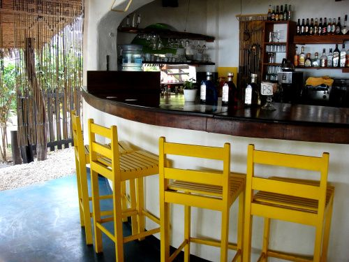 yellow barstools at a restaurant in tamarindo