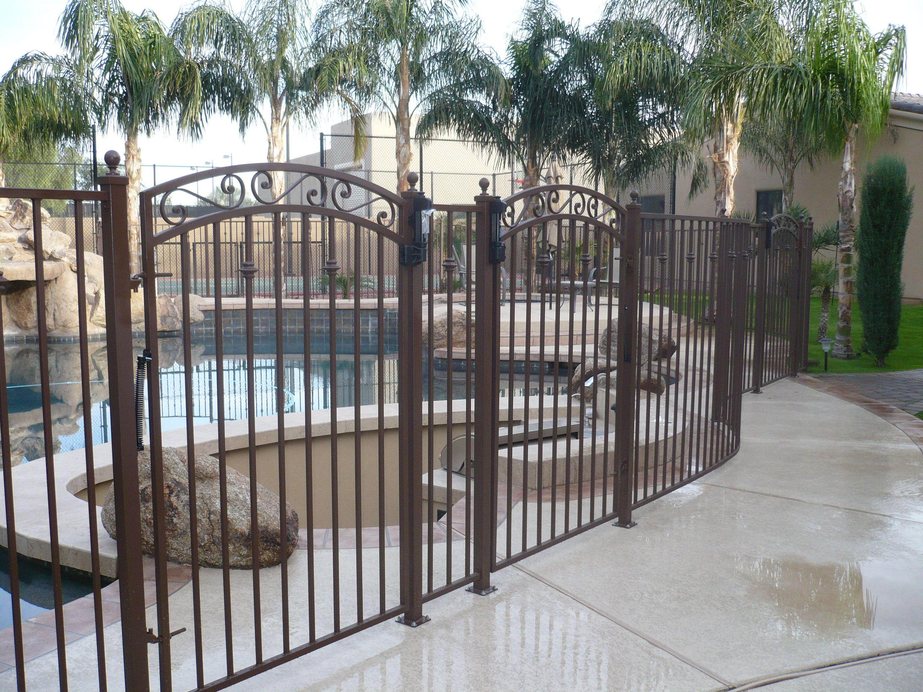 wrought iron fence gate. We Chose To Go With This Wrought-Iron Pool Fence - Rust Powder-coat, Curved Fence, Knuckle Design, Balls On Posts, Arched Gate W/ Scroll Design And Wrought Iron