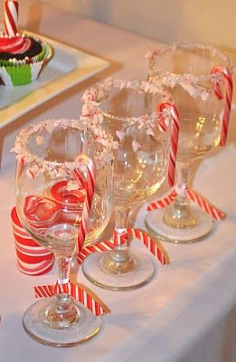 Dip glasses/mugs in white chocolate and then in crushed peppermint - hook a mini candy cane on the rim - fill with hot cocoa, eggnog, or any other holiday drink of your liking!