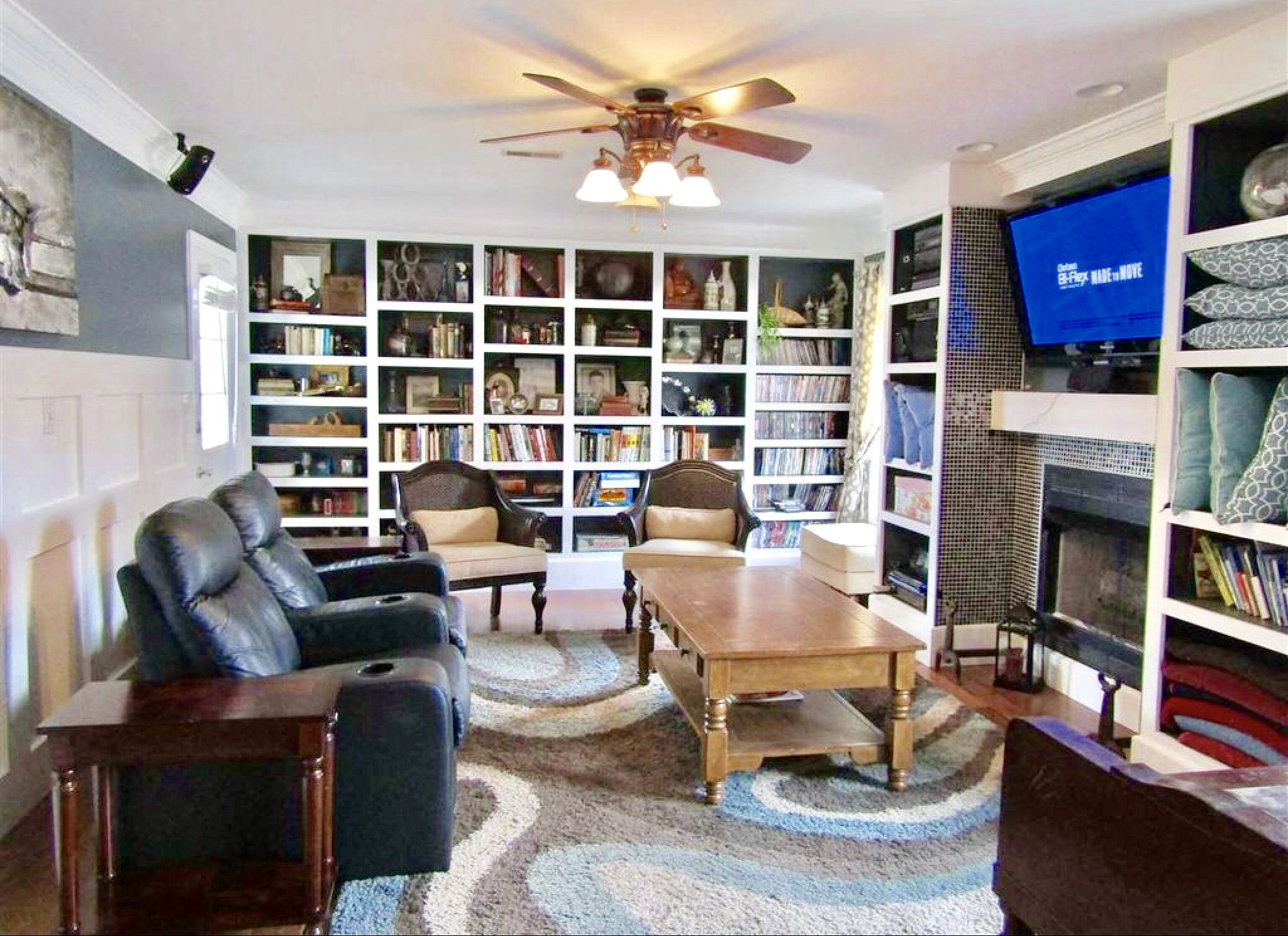 Fantastic family room with tons of storage Built ins galore
