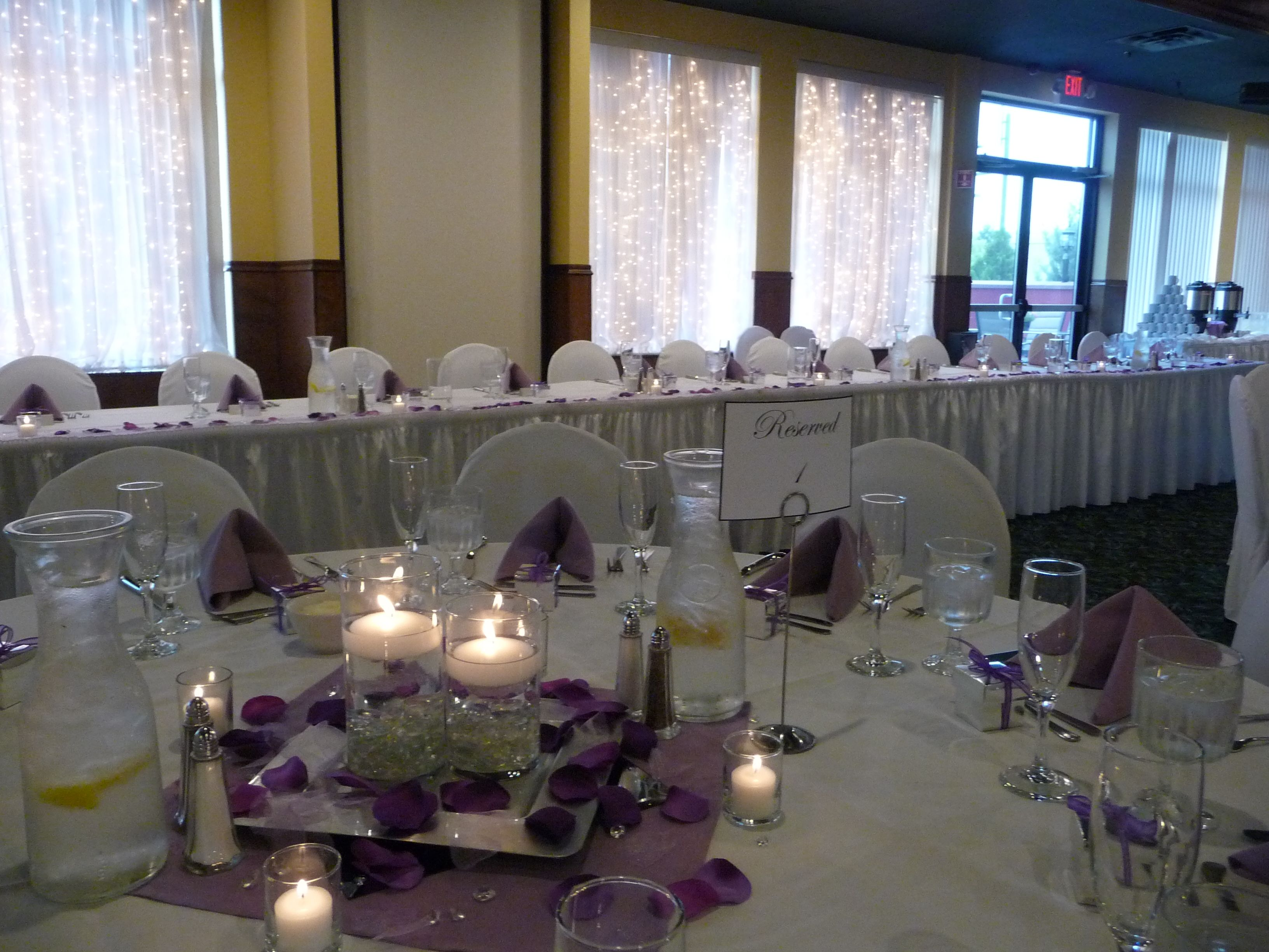 Tovsen Wedding 8.2.14 Rockwoods Banquet Center. Purple Centerpieces, floating candles, 3 tier vases. Reserve Table 1 www.rockwoodsgrill.com