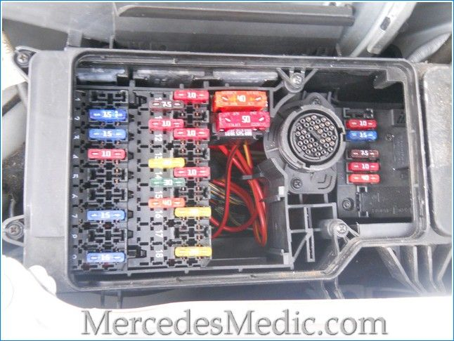 Fuses on Mercedes Benz E Class W210 are located in several