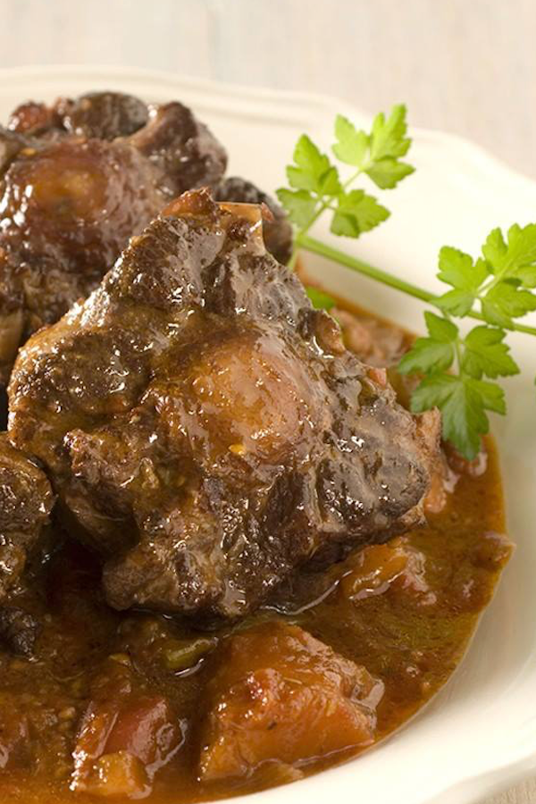 Try This Authentic Jamaican Oxtail Recipe Sandals Blog Cooking Oxtails Haitian Food Recipes Jamaican Dishes