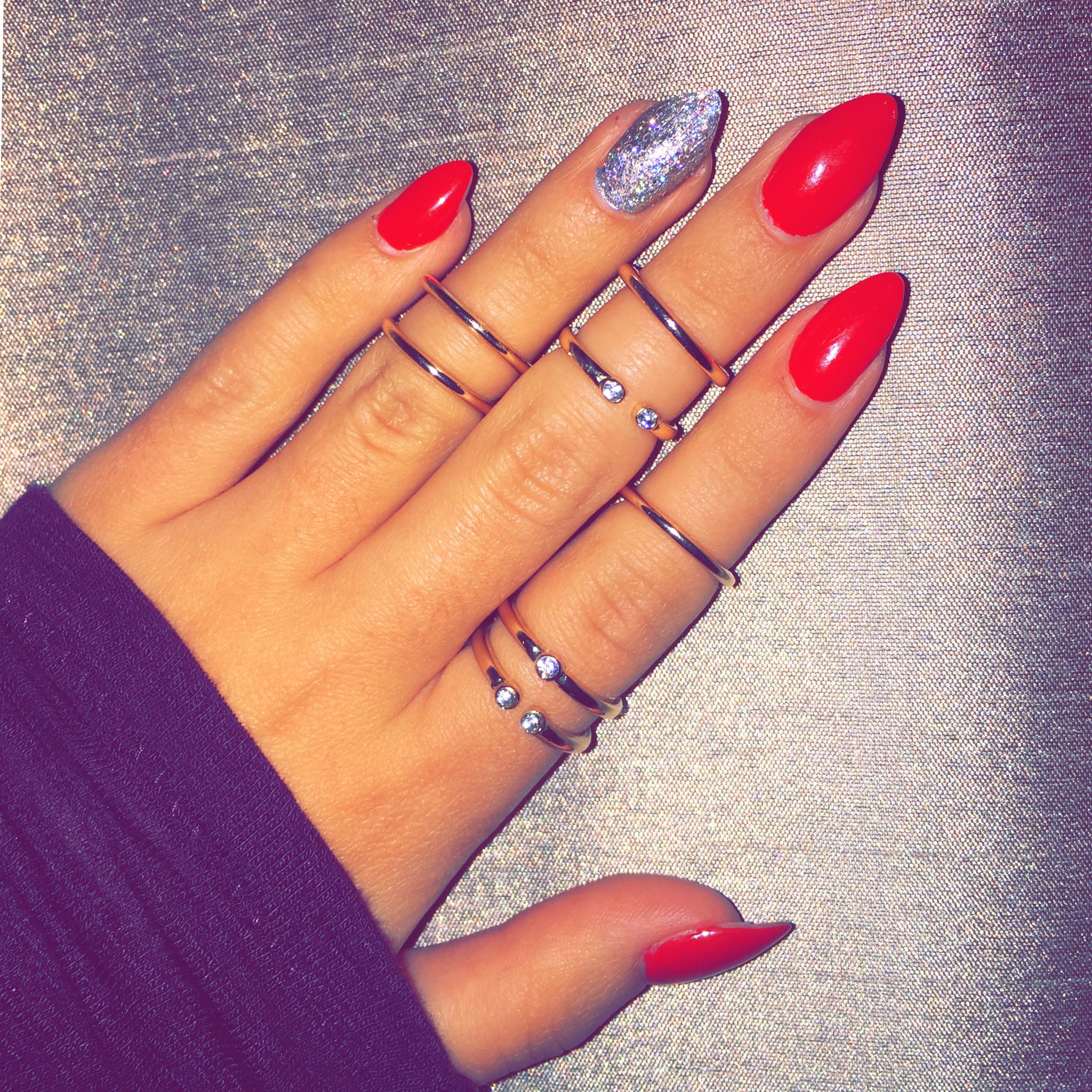 Red stiletto nails with silver glitter accent paired with 14k gold ...