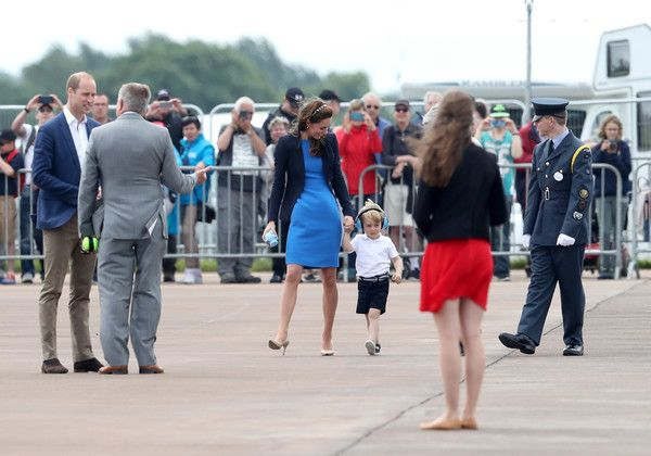 Kate Middleton Photos - Prince William, Duke of Cambridge (L), Catherine, Duchess of Cambridge and Prince George arrive for a visit to the Royal International Air Tattoo at RAF Fairford on July 8, 2016 in Fairford, England. - The Duke & Duchess Of Cambridge Visit The Royal International Air Tattoo
