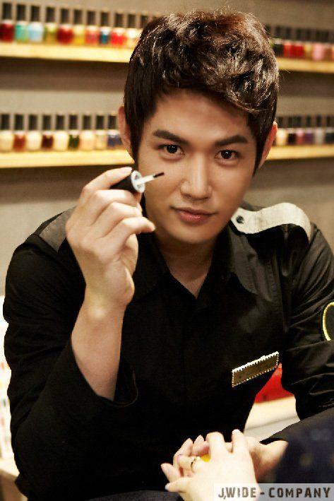 Asian men doing nails
