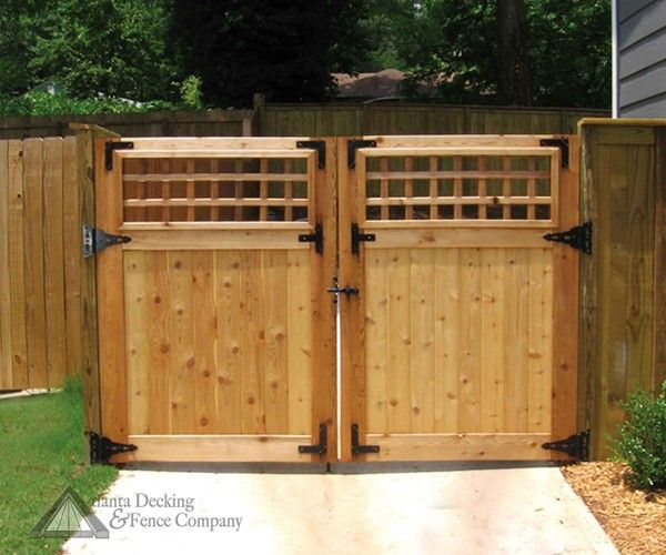 Driveway gate to the back yard after the first gate in for Wooden front gate designs